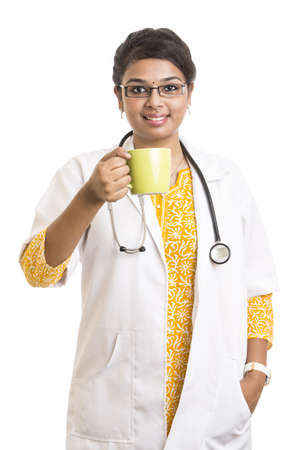 Indian petty female doctor with tea cup on white photo