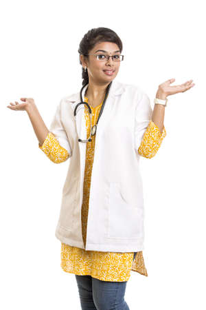 A smiling young Indian Female Doctor welcoming on white. photo