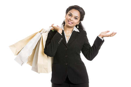 buisness woman: Young business woman with shopping bags over white background