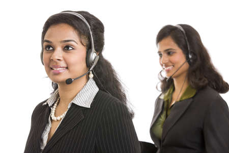 Attractive young people working in a call center photo