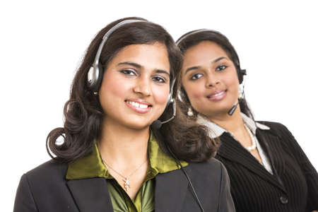 Attractive young people working in a call center Stock Photo - 18162826