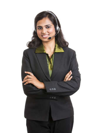 Happy young Indian call centre employee smiling with a headset over white photo
