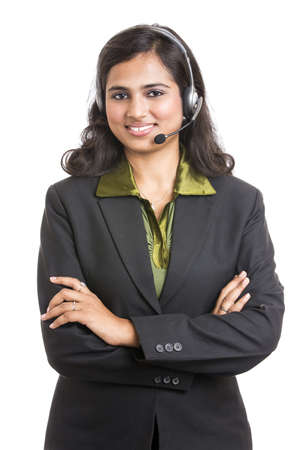 indian professional: Happy young Indian call centre employee smiling with a headset over white
