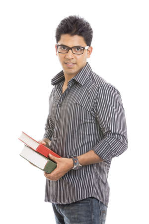 Indian young student carrying books on white  photo