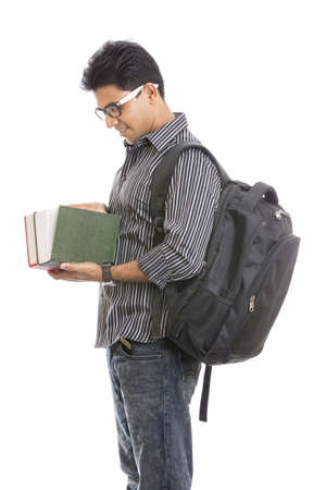 indian boy: Indian young student carrying books on white  Stock Photo