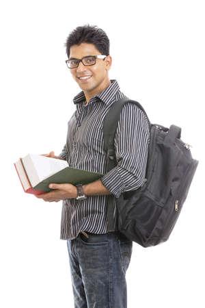 handsome student: Estudiante indio joven que lleva los libros en blanco Foto de archivo