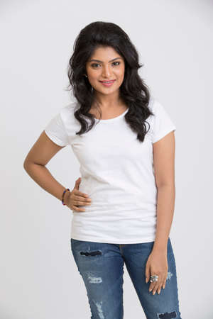 girl legs: Smiling Indian pretty woman posing on white background.