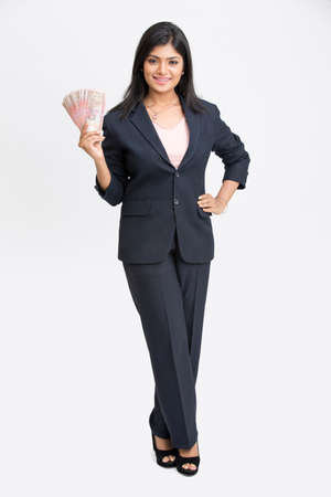 rupee: Cheerful young business woman with rupee notes in her hands Stock Photo