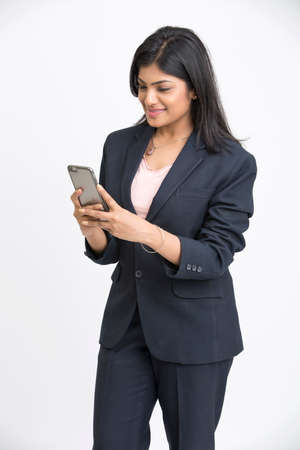 suites: Smiling business woman using phone, isolated on white background