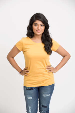 casual clothing: Atractive indian model posing on white