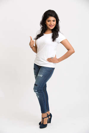 Indian beautiful woman showing thumbs up on white background.