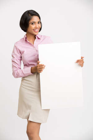 presenting: Smiling Indian Businesswoman holding with white board