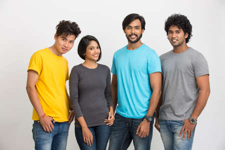 four people: Cheerful group of Indian young friends on a white background. Stock Photo