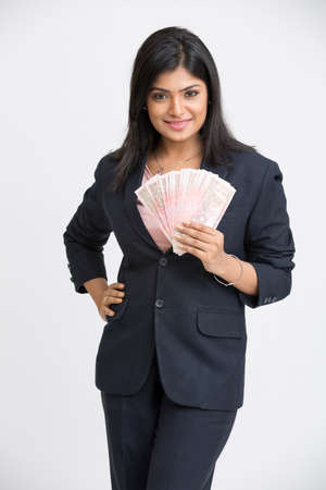 hispanic woman: Happy young business woman with rupee notes in her hands