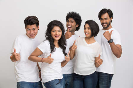 successful student: Happy group of Indian friends. Mixed race group on a white background. Stock Photo