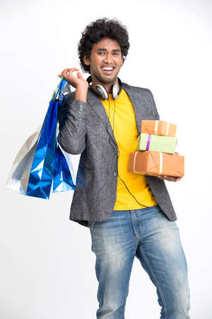 carry on: Overloaded man with shopping bags and gifts on white.