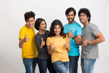 young friends: Cheerful group of Indian young friends on a white background. Stock Photo