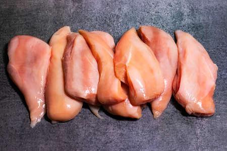 Chicken Breast Fillet Boneless cut isolated with dark background Stock fotó - 155450648