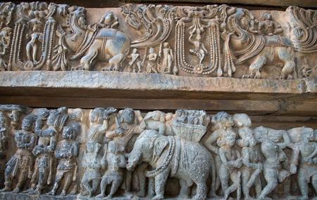 soapstone: The mystic animal and war scenes carved in Hoysaleshwara temple at Halebidu, Hassan district, Karnataka state, India, Asia