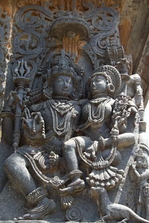 soapstone: Parvati sitting on the lap of Lord Shiva; carved in Hoysaleshwara temple at Halebidu, Hassan district, Karnataka state, India, Asia Stock Photo