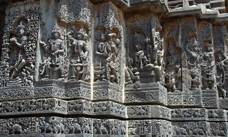 soapstone: God, Goddess, and dancers carved in Hoysaleshwara temple at Halebidu, Hassan district, Karnataka state, India, Asia Stock Photo