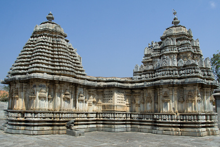 Kadamba shikhara (tower) (left) and dravida shikhara (right) with kalasha (pinnacle) on top in Lakshmi Devi temple at Doddagaddavalli, Hassan district, Karnataka state, India, Asia