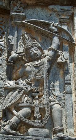 soapstone: Matsya bhedha; Arjuna aiming at fish looking at its reflection; carving in Hoysaleshwara temple at Halebidu, Hassan district, Karnataka state, India, Asia Stock Photo