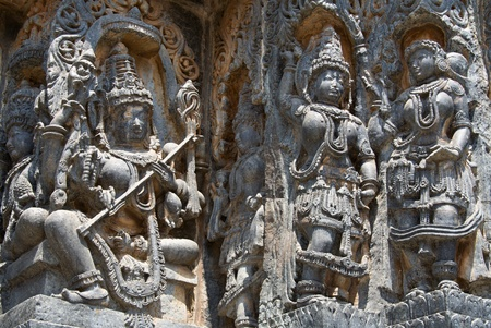 soapstone: Goddess and dancers carved in Hoysaleshwara temple at Halebidu, Hassan district, Karnataka state, India, Asia Stock Photo