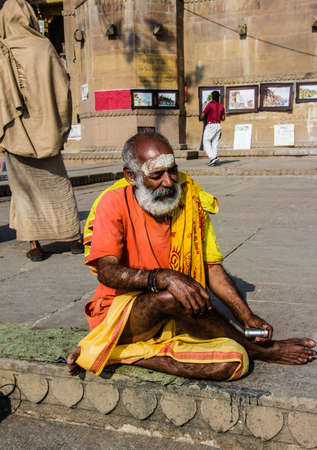 A sadhu, or holy man, sitting on the ghats of the holy hindu city of Varanasi
