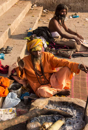 two sadhus sitting on the ghats of the holy city of Varanasi
