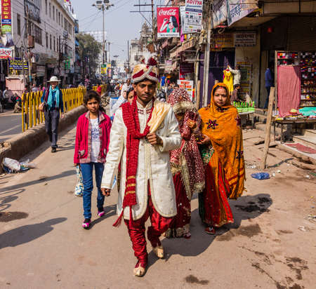 The groom is leading his bride through the city towards the ghats of Varanasi