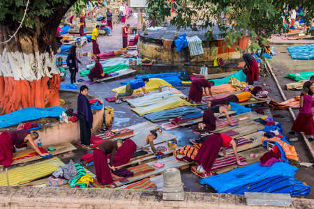 People are performing prostrations near the famous Mahabodhi temple, India