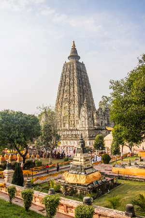 The famous Mahabodhi temple in Bodhgaya, India  It is the place, wher Buddha became enlightened   all faces blurred