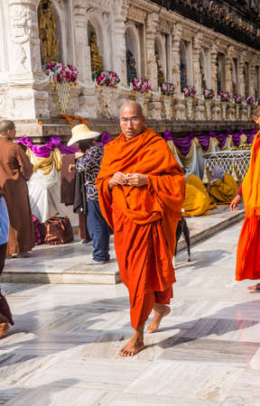 many people from all over the world are circling mahabodhi temple, India
