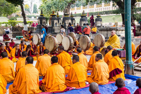 chanting: Tibetan monks are celebbrating a ceremony beneath the bodhi tree, under which the buddha became enlightened  They are chanting, blowing whistles and holding up their drums Editorial
