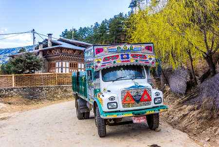 atypical: Atypical bhutanese truck, colorful and embroidered, is standing on a road in Jakar, Bumthang, Bhutan