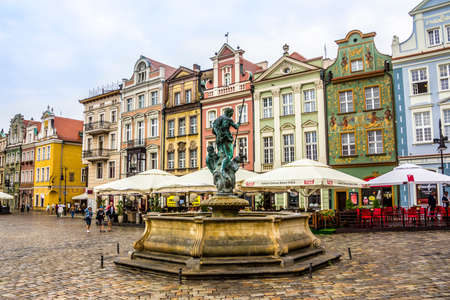 houses from the 16th century at the old market of Poznan, Poland  In the forground is a historic fountain