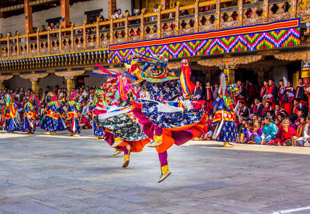 bhutan: masked dancers at  drupchen festival in the dzong of Punakha, Bhutan  Drupchen festival is taking place yearly in march