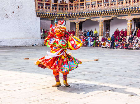 masked dancers at  drupchen festival in the dzong of Punakha, Bhutan  Drupchen festival is taking place yearly in march
