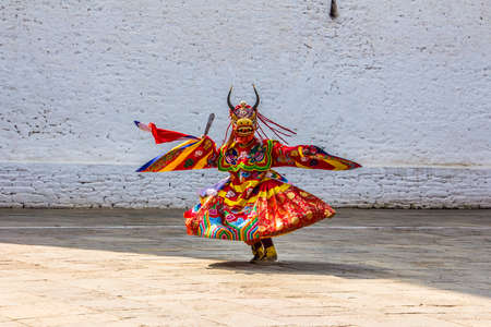tantric: masked dancers at  drupchen festival in the dzong of Punakha, Bhutan  Drupchen festival is taking place yearly in march