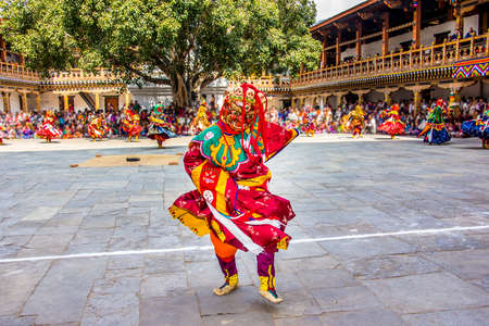 tantric: masked dancers at  drupchen festival in the dzong of Punakha, Bhutan  Drupchen festival is taking place yearly in march   Unrecognizable persons