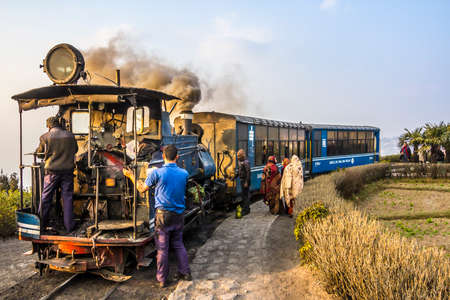 narrowgauge: The historic narrow-gauge train of darjeeling at a stop on the route