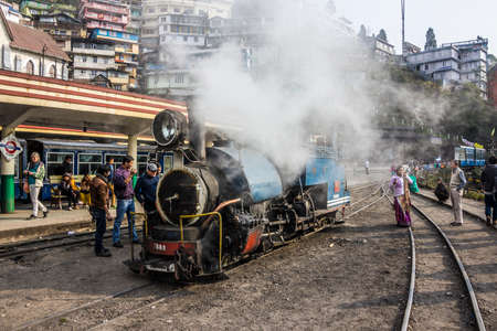 narrow gauge railways: The historic narrow-gauge steem-engine of darjeeling  The picture shows it at the station of Darjeeling