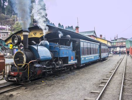 narrow gauge railway: The historic narrow-gauge train of Darjeeling is running between  Darjeeling and Ghoom of Ghoom   unrecognizable persons
