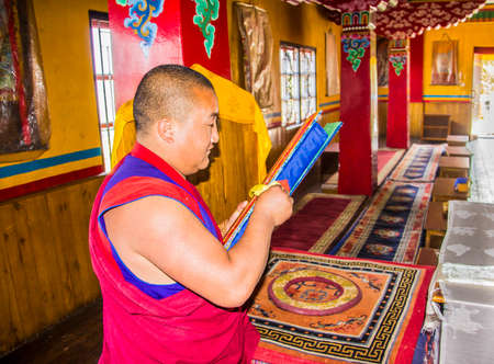 monch: A monch in yung drung kundrak ling bon monastery near Ravangla, India, is looking into the scriptures. Editorial