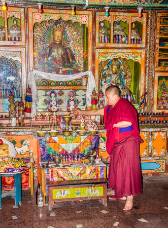 ling: A monch inside yung drung kundrak ling bon monastery near Ravangla, India, is offering food to the buddha.