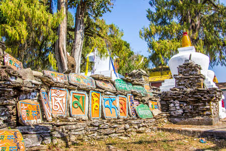 mani: A mani wall in Tashiding, Sikkim, India, with stones, engraved with buddhist prayers in tibetan script. Stock Photo