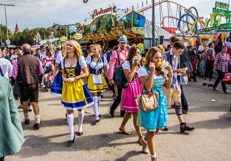 Oktoberfest Munich  Young people, dressed in dirndls, are having fun