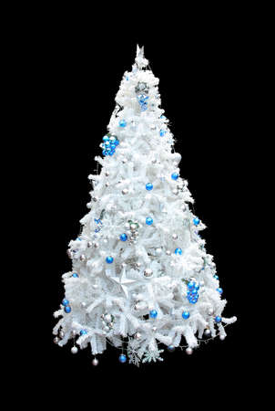 A beautiful white artificial christmas tree with blue and silver spheres. Isolated on a black background