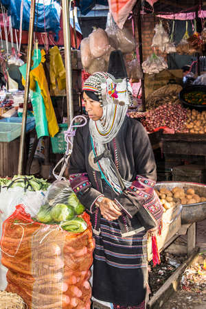 Woman of the Akha tribe on the market of Keng Tung in the north of Myanmar